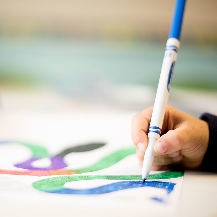 Child coloring with marker